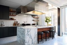 Sleek Italian Calacatta marble perfectly at home in this Bon Appetite World Trade Center Kitchen.