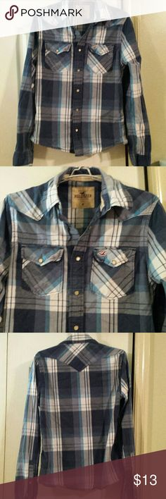 Hollister Plaid Button Down. Juniors Medium. Plaid button down by Hollister. Beautiful Pearl snaps. No holes or stains, but has been worn and washed. In good used condition. Size Juniors Medium. Hollister Tops Button Down Shirts