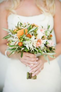 Sprigs of greenery and hypericum berries give texture to this pretty springtime bouquet. Dia Rao Photography. Anne Mendenhall Flowers.