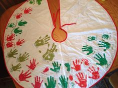 Tree-skirt Handprint Christmas Tradition  Every year since 2004 my children have placed their handprints on the underside of my tree skirt. This has become a tradition they all look forward to with GREAT anticipation. We alternate colors yearly with red and green for easier viewing.   You may notice that there are a couple footprints on it as well; we did footprints with my handicapped son twice before he could really use his hands.  This has become one of my most prized possessions.  :)