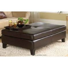 Simple and elegant coffee table size ottoman with storage. Available in Brown, Black and Cream bicast leather