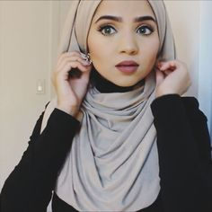"""Hijab style for girlies who love wearing earrings 😄 Cream Jersey hijab from @voilechic  Lenses from @misaki_cosmetics use the code """"SAIMA"""" to get a discount"""