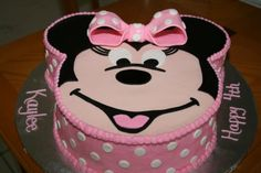 """Kaylee's 4th Birthday - Minnie Mouse birthday cake for my grand-daughter's 4th birthday.   10"""" round with 6"""" ears.  Fondant face and accents.  Thanks to Jaklotz1 for inspiration."""