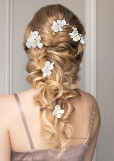 Love this romantic bridal hairstyle, all the benefits of an up-do, but it still shows the length and beauty of long hair