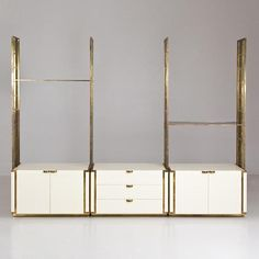 Talisman An Italian Cream Lacquered and Gilt Bronze Framed Etagere -
