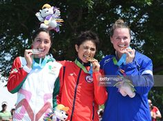 July 11 - Triathlon - Women. Paola Diaz of Mexico, Barbara Riveros of Chile and Flora Duffy of Bermuda celebrate silver, gold and bronze respectively in the women's triathlon at Ontario Place during the during the 2015 Pan American Games for the 2015 Pan American Games in Toronto, Canada.