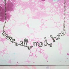Hey, I found this really awesome Etsy listing at http://www.etsy.com/listing/83021329/were-all-mad-here-necklace-alice-in