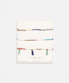 Lot bracelets pompons - OYSHO