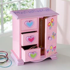 Little girls will adore our keepsake box (with all its drawers and compartments) just as much as they love the treasures they'll keep in it!