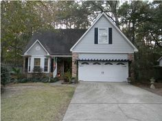 Move In Ready!! This home is a must SEE and will WOW you as soon as you walk in the door! 4/2.5 home features extra tall ceilings, newer hardwood floors, newer carpet in the upstairs bedrooms and NO carpet downstairs! Living room features wood burning fireplace, tall ceilings and hardwood floors. Seller currently uses the formal dining room as an extension of the living room. Spacious kitchen with SS appliances, bar area, tons of cabinet space...