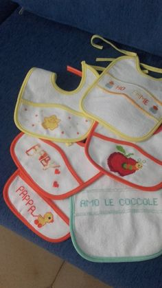 Bibs with cross-stitch embroidery made by @luciacanino *** Le Maddine & Maddy https://www.facebook.com/groups/531953423561246/ *** #madeinfacebook #lemaddine #handmade #handcrafted #instagram #instapic #instagood #picoftheday #instacool #handmade #cool #cute #embroidery #sewing #crossstitch #bib #white #colorful #apple #lunch #dinner #newborn #baby #eat #food #piccolecreazionidilucia