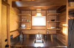 Humble plywood, all-thread and some nuts make for surprisingly elegant shelving. (Photo: Shelter Wise)
