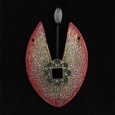 Polymer clay jewelry by Helen Breil.  http://www.helenbreil.com