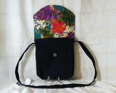 $20.00 #DarkBlue #SwingBag #embroidery #MessengerBag #MagnetSnapSecure #denim Flower Power Tote Bag for Mother's Day Dark Blue denim Swing Tote Bag is just the right size to take if you light to travel light. Completely lined with a couple of inside pockets for your cell phone and car keys, Embroidered flower design on the front which complements the lining fabric inside. Nice long strap that you can swing the bag across your front. Bag as a magnet snap for closing the back securely…