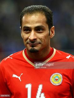 Salman Isa of Bahrain lines up for national anthems during the 2010 FIFA World Cup Asian qualifier match between Japan and Bahrain at Saitama Stadium...