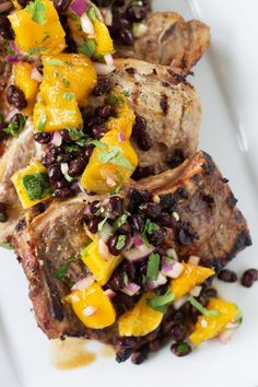 Citrus Marinated Pork Chops with Mango Black Bean Salsa -a juicy marinated pork chop grilled to perfection. Topped with a sweet and savory mango salsa! Mango Recipes, Mexican Food Recipes, Ethnic Recipes, Recipes Using Ground Beef, Marinated Pork Chops, Black Bean Salsa, How To Cook Pork, Man Food, Easy Dinner Recipes