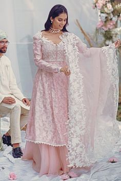A cotton net peshwas in a beautiful shade of pink. The hand worked body is worked in thread, sequins and flowers with lace finishing. Designer Party Wear Dresses, Kurti Designs Party Wear, Lehenga Designs, Indian Designer Outfits, Mehndi Designs, Designer Wear, Party Dresses, Pakistani Fashion Casual, Pakistani Dresses Casual