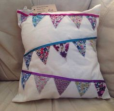 Handmade appliquéd designer bunting cushion by OhhSewLovely, $15.93
