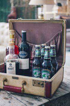 bar in a vintage suitcase  Designed/Planned by Jove Meyer Events Photographed by Amber Gress  Furniture Rentals by Patina Rentals