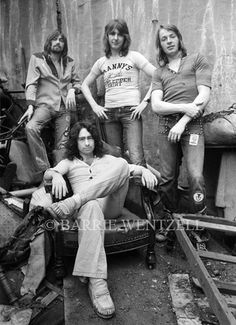 """Bad Company - an English rock band founded in 1973 by singer Paul Rodgers, drummer Simon Kirke, guitarist Mick Ralphs & bassist Boz Burrell. Bad Company enjoyed great success throughout the 1970s. Many of their singles, such as """"Bad Company"""", """"Can't Get Enough"""", """"Good Lovin' Gone Bad"""", and """"Feel Like Makin' Love"""", remain popular with rockers of both the past and present, and their hits remain staples of classic rock radio."""