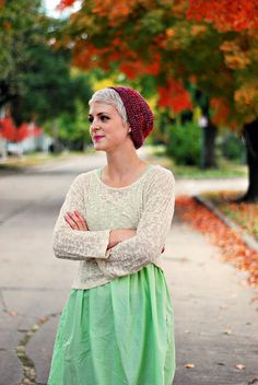 Pixie cut with beanie, sweater over dress.