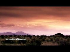 Golden time lapse clouds sail over mountains and a windy desert.     Purchase this clip at A Luna Blue:   http://www.alunablue.com/variety-stock-video/variety-03/clip-12.html     A Luna Blue Stock Video.   Imagery for Your Imagination.   http://www.alunablue.com