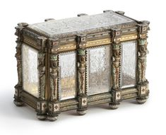 An Austrian silver-gilt, enamel, and rock crystal casket, maker's mark JW conjoined in oval, Vienna, circa 1880.