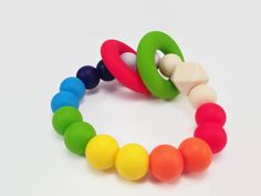 SILICONE TEETHING BRACELET made in new zealand Check out this item in my Etsy shop https://www.etsy.com/nz/listing/501360508/teether-bracelet-rainbow-colour-teething
