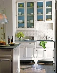 Pop of color inside glass front cabinets!