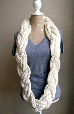 "An elegant ""twist"" on the classic, crochet infinity scarf. This braided scarf is so simple to create and works up into a head turning, unique piece. &nbs"