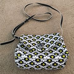 Vera Bradley Satchel This is an adorable black and yellow damask looking satchel from Vera Bradley. It has only been used once and is in excellent condition. It has a zip pocket on the inside that separates two sides. The material is not cloth. It is like a leather which makes it very easy to wipe off if it gets dirty. Vera Bradley Bags Satchels