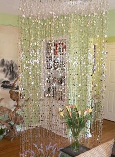 glam wall garland backdrop..can buy on this site. need to measure wall..comes in different beads too