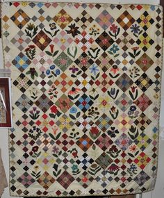 We are very fortunate to have so many wonderful quilters call Fat Quarters Quilt Shop home. Addie did an absolutely amazing job making the quilt 'Lisa's Flower Garden' from Primitive Gatherings! Thank you so much Addie for allowing us to display your wonderful quilt in the shop!!!