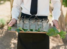 The couple's signature cocktails were garnished with sprigs of lavender and displayed on a wooden tray. #cocktaildrinks #cocktailhour Photography: Elizabeth Messina. Read More: http://www.insideweddings.com/weddings/catriona-mcginn-and-mark-paul-gosselaar/428/