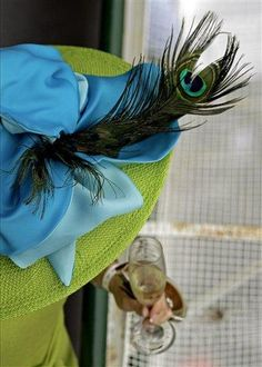Fascinating in this Peacock Tail Feathered Hat!