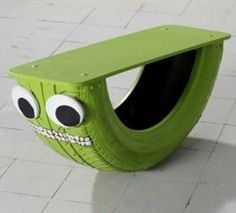 Upcycled green rocker made from an old tire.