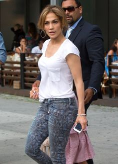 Singer Jennifer Lopez and her friend actress Leah Remini seen leaving the Gansevoort Hotel in New York City, New York on July 10, 2014. Earlier Jennifer posted a selfie on Instagram with First Lady Michelle Obama when both were at the 2014 LULAC Convention.