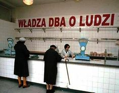 "PRL i pelne towarow sklepy.""The state looks after the people"" An empty food shop during Communist times in Poland."
