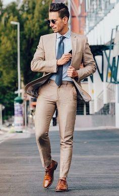 with a crisp dapper combo with a well tailor tan linen suit with a light blue white striped shirt blue tie brown brogues shoes sunglasses Costume En Lin, Mode Costume, Khaki Suits, Brown Suits, Beige Suits For Men, Guys In Suits, Mens Fashion Suits, Mens Suits, Suit Men