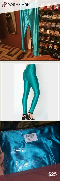 NWT Teal/ turquoise blue disco pants. **Holiday Sale** Brand new with tags! Tag says L but they run small would fit US 4-6. Not AA they are unbranded. Thick great quality. PRICE FIRM American Apparel Pants Leggings