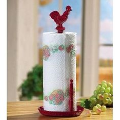 Buy a standing paper towel holder, glue on a spray painted dollar store or toy chicken.