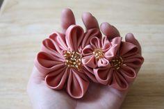 Pointed Kanzashi Flower Tutorial by iriskh, via Flickr ... http://byov.blogspot.com/2010/08/how-to-pointed-kanzashi-flowers.html#
