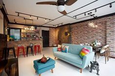 Beautiful colorful stools with complementing brick wall and settee style centrepiece give a perfect look to the room designed by I-Bridge Design.   Project by I-Bridge Design  #interiordesign #livingroom #renovation #cosy #home #sghomes #idsg #housedecor #renopedia #hdb #homestyling #furniture #furnishing #bedroom  #minimal #picoftheday #followme #follow #archidaily #beautiful #design #abstract