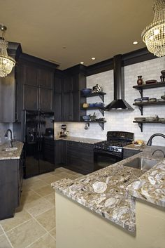 Stacked cabinetry with custom moldings in this eclectic kitchen. White subway tile.