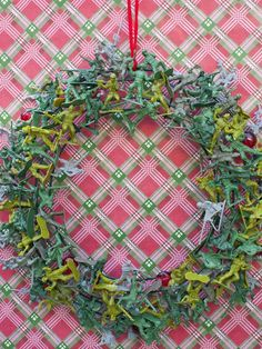 9 Clever, Kitschy Holiday Wreath Ideas : Decorating : Home & Garden Television    Would be fun for a Toy story themed party OR welcoming a soldier home, yes? :)  I adore a themed welcome wreath :) !