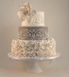 Loving the scroll work which shows really well against the grey background and the beautiful ruffled flowers