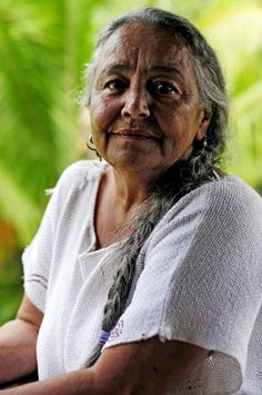 Naniki Reyes Oscario - a Taino Indian elder in Puerto Rico, poses for a portrait outside her home in the central mountains. Oscario said she is frustrated because despite cultural and historical recognition as an indigenous community, the Taino nation is not federally recognized by the governments of the United States and Puerto Rico. Photo by Brandon Quester
