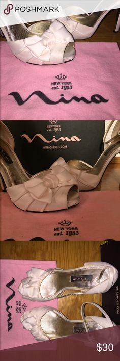 ⭐️️30% Bundle Sale⭐️ Nina white satin heels Slightly stained on the bottom. Used once for wedding. Comes with box and little purse to put them in Nina Shoes Heels
