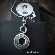 Fine Silver Jewellery design, celtic spiral in abstract form with shades of black patinations, bespoke, original handmade work by Richard Andreucetti Irish Artist. DM for commissions