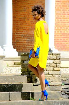 yellow dress with blue clutch and shoes